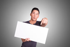 Young man with white cardboard Stock Images