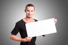 Young man with white cardboard Stock Photography
