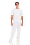 Young man white clothes. Happy young man in white clothes isolated on white background stock images