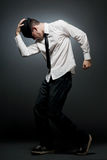 Young man in white shirt and black hat dancing. Royalty Free Stock Photo