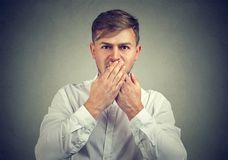 Man covering mouth in silence stock photos