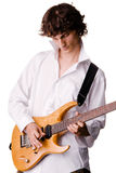 Young man in white shirt playing electric guitar Stock Photos