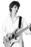 Young man in white shirt playing electric guitar Royalty Free Stock Photos