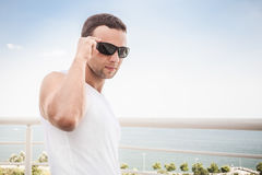Young man in white shirt and sunglasses Stock Photos