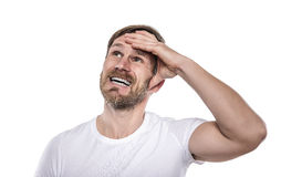 Young man in a white shirt is thinking intensely. Royalty Free Stock Photos