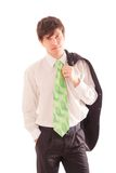 young man in white shirt and tie holds striped coat on shoulder Royalty Free Stock Photos