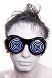 Young man with white skin in strange blue glasses Stock Photography