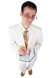 Young man in white suit with notebook in hands Royalty Free Stock Photography