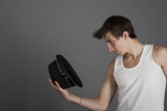 Young man in a white t-shirt with a black hat Royalty Free Stock Photography
