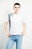 Young Man. White T-shirt and Jeans Royalty Free Stock Image