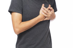 Young man in white t-shirt with strong heart attack Royalty Free Stock Photography