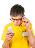 Young Man with White Vial Stock Photography