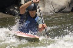 Young man whitewater kayaking Royalty Free Stock Photos