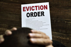 Young man who has received an eviction order Royalty Free Stock Image