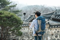 Young man who travels to Korea is taking pictures using his smartphone. A young man who travels to Korea is taking pictures using his smartphone Royalty Free Stock Photo