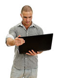 Young man wih laptop. Royalty Free Stock Images