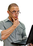 Young man wih laptop thinking. Royalty Free Stock Photography