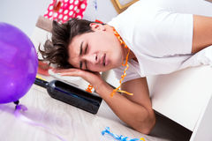 The young man after the wild christmas party. Young man after the wild Christmas party Stock Images