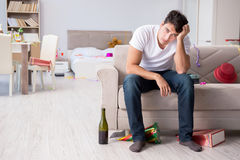 The young man after the wild christmas party. Young man after the wild Christmas party Stock Image