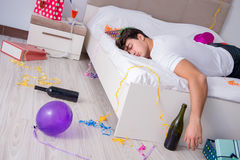 The young man after the wild christmas party. Young man after the wild Christmas party Royalty Free Stock Images