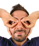 Young man winces with his hands over his eyes. Royalty Free Stock Image