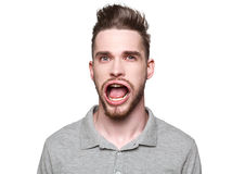 Young man with windblown mouth Stock Image