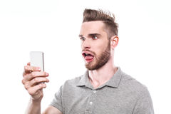 Young man with windblown mouth Stock Images