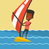 Young man windsurfing in the sea. Stock Photo