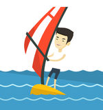 Young man windsurfing in the sea. Royalty Free Stock Photography