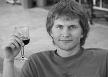 Young man with wine Royalty Free Stock Photography