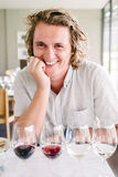 Young man at a wine tasting Royalty Free Stock Image
