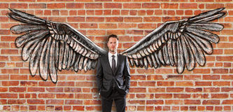 Young man with wings Stock Photography