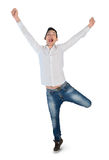 Young man winner hands up Stock Photography