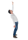 Young man winner pointing up Royalty Free Stock Images