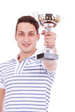 Young man winning the first place trophy Royalty Free Stock Image