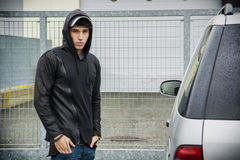 Young man in a winter anorak with hood Royalty Free Stock Images