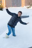 Young man in winter boots fell into a deep white Royalty Free Stock Images