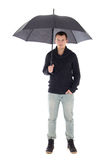 Young man in winter clothes posing with umbrella isolated on whi Royalty Free Stock Photography
