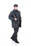 Young Man In Winter Down Clothes. Young man in winter warm down jacket on isolated background royalty free stock photography