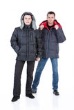 Young Man In Winter Down Clothes. Young man in winter warm down jacket on isolated background stock images