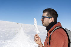 Young man in the winter mountain Royalty Free Stock Photo