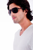Young man winth sunglasses. Portrait of young man with black sunglasess on wite isolated bacground stock photography
