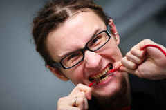 Young man with a wire in the teeth Stock Photo