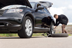 Free Young Man With A Roadside Puncture Royalty Free Stock Image - 40625066