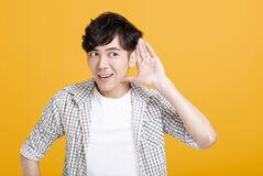 Free Young Man  With Hand Over Ear Listening And Hearing Royalty Free Stock Images - 173378789