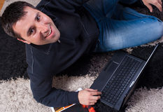 Young Man With Laptop At Home Stock Images
