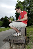 Young Man With Notebook Stock Images