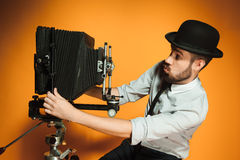 Free Young Man With Retro Camera Royalty Free Stock Photography - 57532367