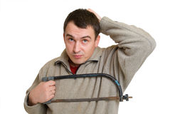 Young Man With Saw Thinking About Repair Royalty Free Stock Photography
