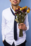 Young man with withered flowers Stock Image